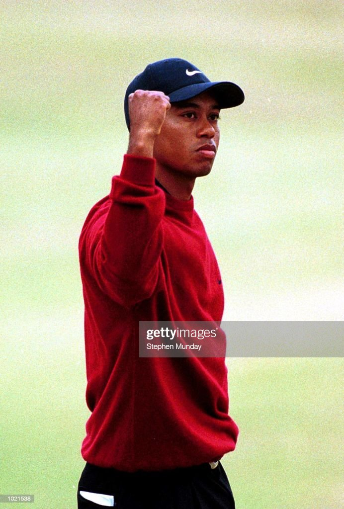 Tiger Woods of the USA celebrates with on the 18th green after victory in the 2000 British Open Golf Championships at the Old Course, St Andrews, Scotland. Mandatory Credit: Stephen Munday/ALLSPORT