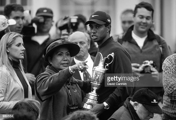 Tiger Woods of the USA holds the Claret Jug as he chats with his mum Kultida after winning the British Open on the Old Course at St Andrews in...