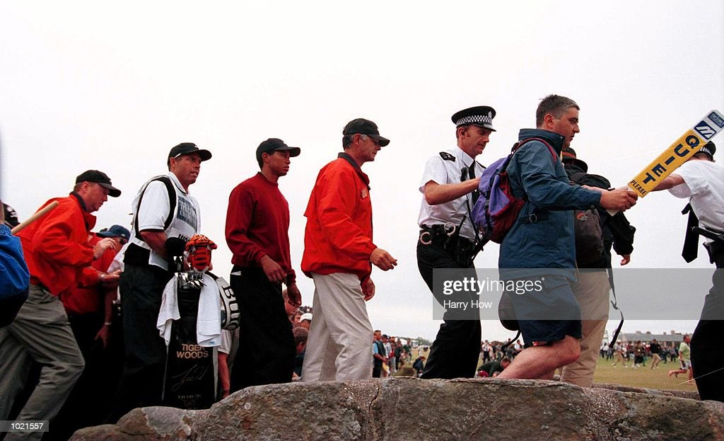 Tiger Woods of the USA is escorted across the Swilken Bridge on his way to the 18th green during the final round in the 2000 British Open Golf Championships at the Old Course, St Andrews, Scotland. Mandatory Credit: Harry How/ALLSPORT