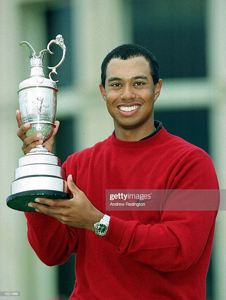 Tiger Woods of the USA with the trophy after winning the British Open Golf Championships at the Old Course, St Andrews, Scotland. Mandatory Credit: Andrew Redington/ALLSPORT