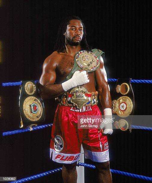 World Heavyweight Champion Lennox Lewis of Great Britain shows off his IBO WBC and WBA title belts during a feature shoot in London Mandatory Credit...