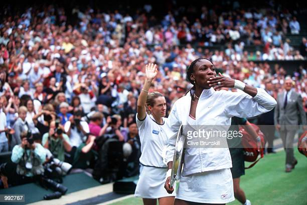 A happy Venus Williams of the USA blows a kiss to the Fans after beating Justine Henin of Belgium during the women's final of The All England Lawn...