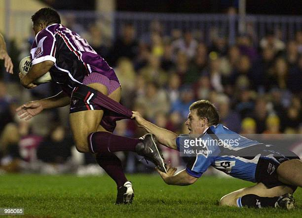 Adam Dykes of the Sharks pulls down John Hoppoate of the Eagles shorts during the round 20 NRL match between the Northern Eagles and the Sharks at...