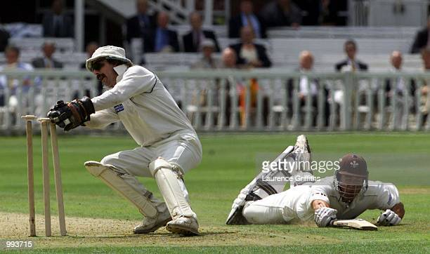 Adam Hollioake of Surrey narrowly avoids a run out by Jack Russell of Gloucestershire during the BH Final between Gloucestershire and Surrey at Lords...