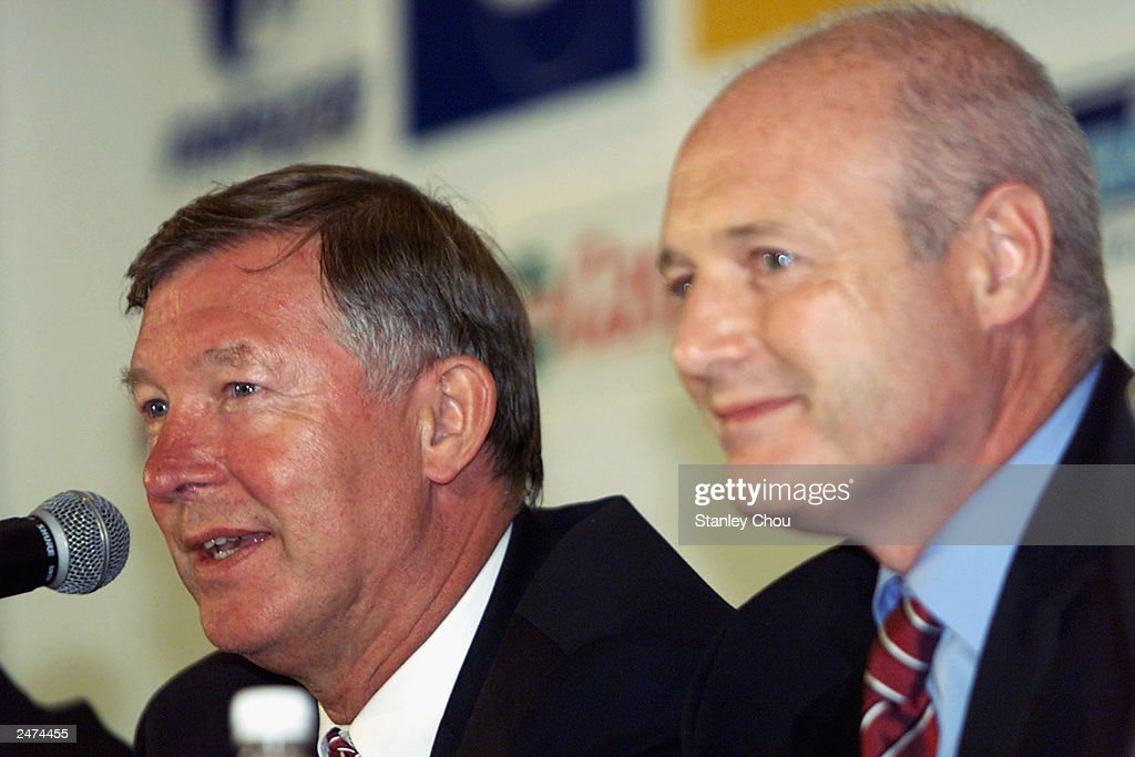 Alex Ferguson, Manager of Manchester United and Peter Kenyon, the Chief Executive at the Welcome Media Press Conference held at the Radisson Hotel, Bangkok during Manchester United final stop of the Far East Tour. Kenyon resigned as Chief Executive of Manchester United September 9, 2003 to take up a position with Chelsea.