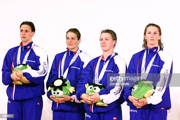 Alison Sheppard Melanie Marshall Rosalind Brett and Karen Pickering of Great Britain's silver medal women's 4X100M Freestyle Relay Team during finals...