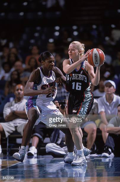 Andrea Nagy of the New York Liberty trying to pass the ball while being guarded by Charlotte Smith during the game against the Charlotte Sting at the...