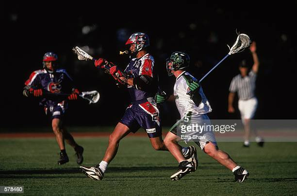 Andy Towers of the Boston Cannons catches the ball as Steven Sambrotto of the Long Island Lizards runs next to him during the Major League Lacrosse...