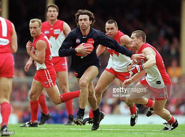 Ang Christou for Carlton in action during round 14 of the AFL season match played between the Sydney Swans and the Carlton Blues held at the Sydney...