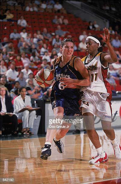 Audrey Savret of the Washington Mystics dribbling the ball to the basket while being guarded by Jamie Redd during the game against the Seattle Storm...