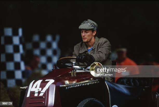 Benetton driver Jenson Button of Great Britain drives a vintage car in vintage clothing during the Goodwood Festival of Speed held in Goodwood...