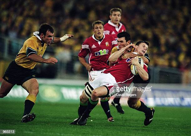 Brian O''Driscoll of the Lions is tackled high by Australia's Daniel Herbert during the Second Test Match between the Australian Wallabies and the...