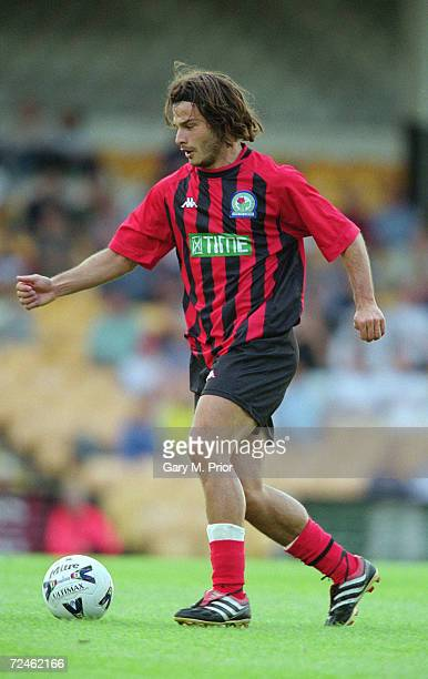 Corrado Grabbi of Blackburn Rovers runs with the ball during the preseason friendly match against Port Vale played at Vale Park in StokeonTrent...