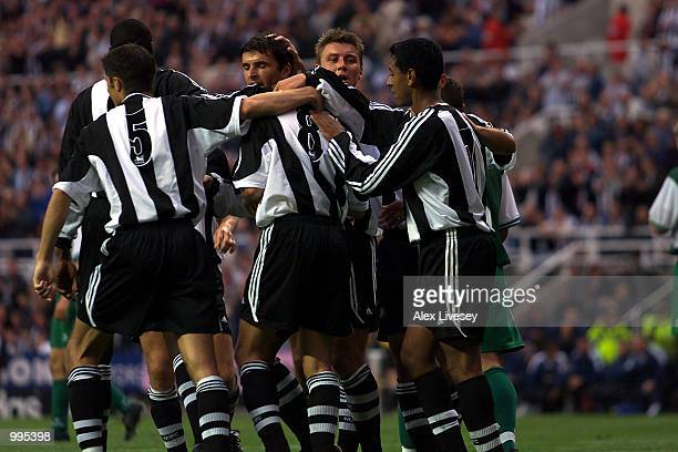 Craig Bellamy of Newcastle celebrates his goal with team mates during the UEFA Intertoto, third round, second-leg match between Newcastle United and...