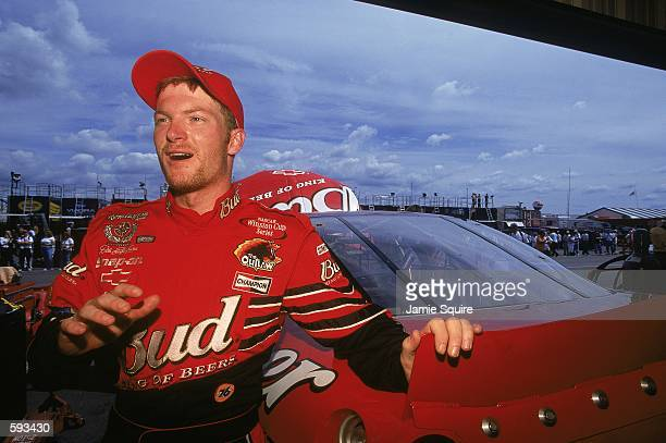 Dale Earnhardt Jr #8 who drives the Chevy Monte Carlo for Dale Earnhardt Inc standing by his car in pit lane during the Pennsylvania 500 part of the...