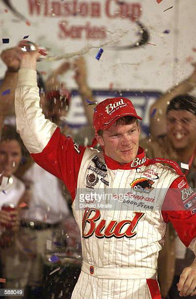 Dale Earnhardt Jr celebrates after winning the NASCAR Winston Cup Pepsi 400 at the Daytona International Speedway Daytona Florida Digital Image...
