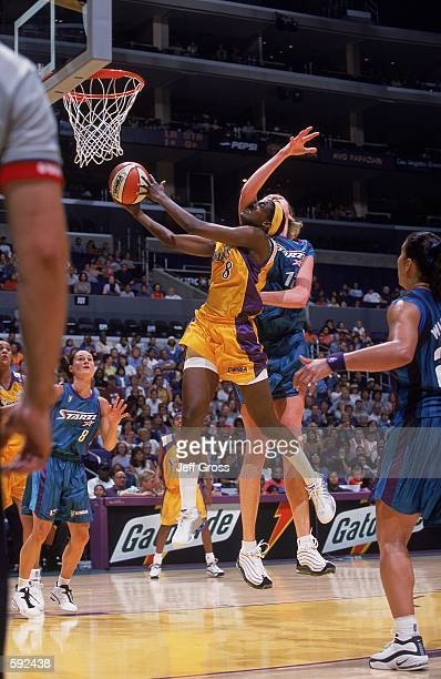 Delisha Milton of the Los Angeles Sparks jumps to shoot a layup during the game against the Utah Starzz at the STAPLES Center in Los Angeles...