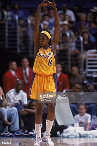 Delisha Milton of the Los Angeles Sparks stretches her arms during the game against the Utah Starzz at the STAPLES Center in Los Angeles California...