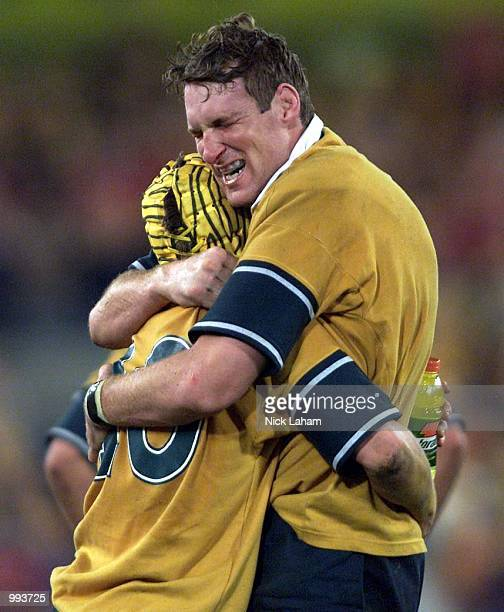 Elton Flatley embraces teammate Justin Harrison of the Wallabies after victory over the Lions during the third Test Match between the Australian...