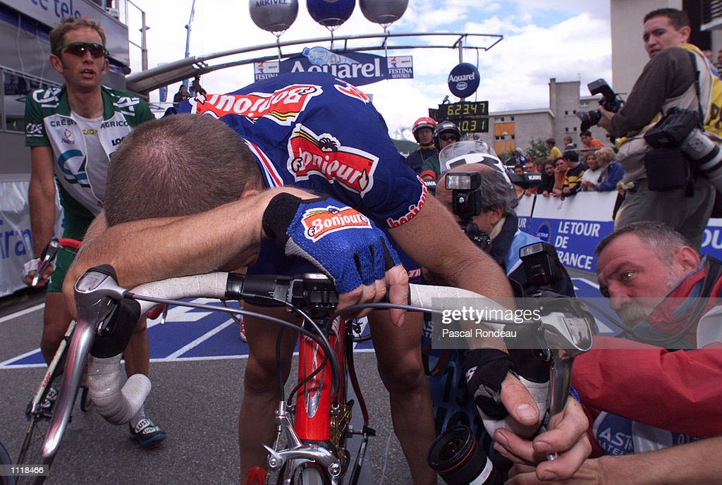 Francois Simon from France and riding for the Bonjour team is exhausted after finishing stage ten and earning the yellow jersey in the 2001 Tour de France from Aixe le Bains to Alpe d''Huez, France. DIGITAL IMAGE Mandatory Credit: Pascal Rondeau/ALLSPORT
