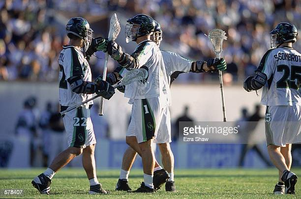 Gary Gait and Casey Powell of the Long Island Lizards are on the field during the Major League Lacrosse game against the Boston Cannons at Cawley...