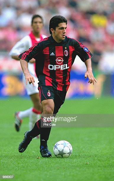 Gennaro Gattuso of AC Milan runs with the ball during the preseason friendly tournament match against Ajax played at the Amsterdam ArenA in Amsterdam...