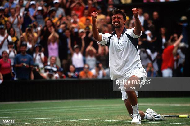 Goran Ivanisevic of Croatia celebrates in tears after winning against Pat Rafter of Australia in the Men's Final's of The All England Lawn Tennis...
