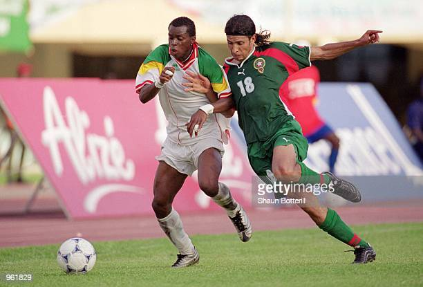 Henri Camara of Senegal battles with Youssef Chippo of Morocco during the CAF 2nd Round Group C World Cup Qualifier between Senegal and Morocco at...