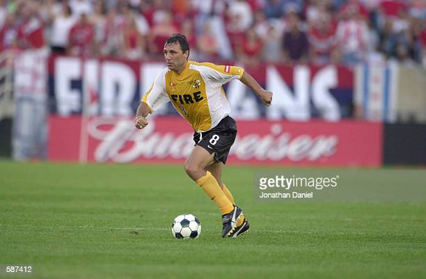 Hristo Stoitchkov of the Chicago Fire moves the ball down field during the match against the Dallas Burn at Soldier Field in Chicago Illinois The...