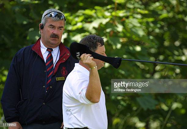 Ian Woosnam of Wales throws his club away after being told by PGA tour official John Paramor that he has too many clubs in his bag and be given a two...