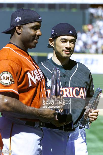 Ichiro Suzuki of the Seattle Mariners and Barry Bonds of the San Francisco Giants hold the Most Votes trophy for the AllStar Game before the AllStar...
