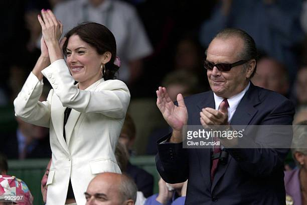 Jack Nicholson and Lara Flyn Boyle cheer Goran Ivanisevic of Croatia win over Patrick Rafter of Australia during the Men's Final of The All England...