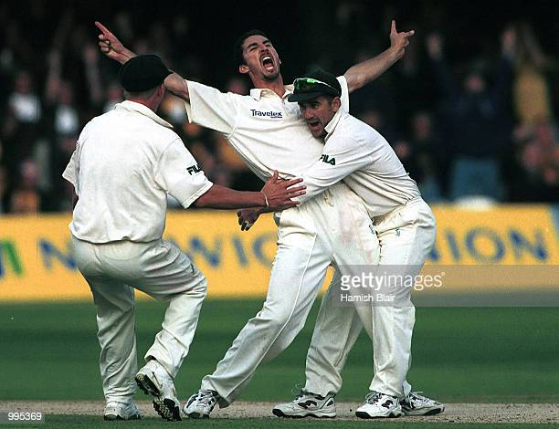 Jason Gillespie of Australia celebrates the wicket of Mark Ramprakash of England with Justin Langer during the third day of the Second Npower Test...