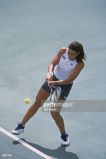 Jennifer Capriati hits a backhand shot during the doubles match against Kimberly Po and Natalie Tauziat for the Acura Tennis Classic at the La Costa...