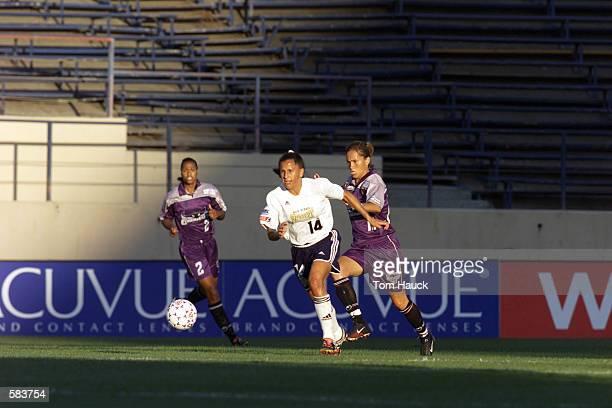 Joy Fawcett of the San Diego Spirit outruns Tisha Venturini of the Bay Area Cyberrays during the WUSA game at Spartan Stadium in San Jose California...