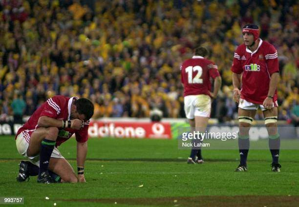 Lions captain Martin Johnson, Rob Henderson and Danny Grewcock dejected after being defeated by the Wallabies during the third Test Match between the...