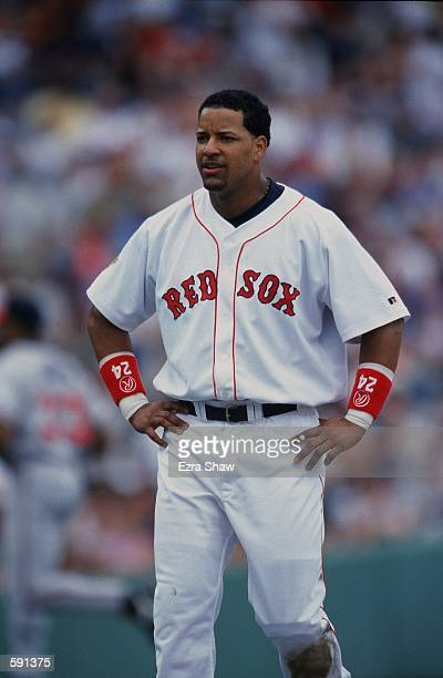 Manny Ramirez of the Boston Red Sox looks on from the field during the game against the Atlanta Braves at Fenway Park in Boston Massachusetts The...