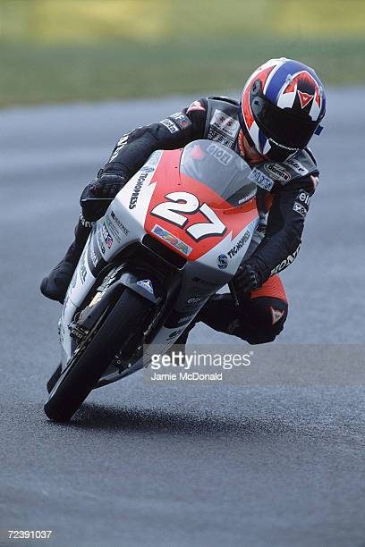 Marco Petrini of Italy puts his Racing service Team Bike through its paces during the 125cc Class British Grand Prix held at Donigton Park Race Track...