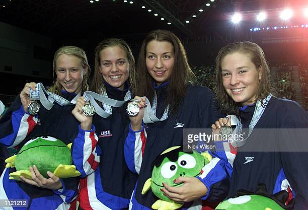 Mary Desenza Megan Quann Erin Phenix and Natalie Coughlin of the USA after winning Silver in the Womens 4x100 Medley Relay at the Marine Messe Pool...