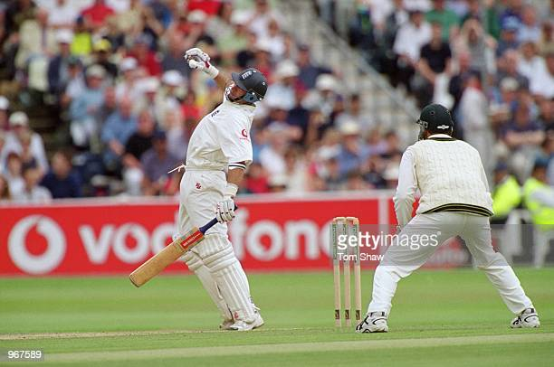 Nasser Hussain of England breaks his little finger and has to retire from the match through injury during the First Test match against Australia...