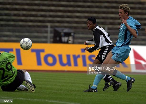 Nolberto Solano of Newcastle chips in the first goal during the Intertoto Cup Semi Final, First Leg between 1860 Munich and Newcastle United at the...