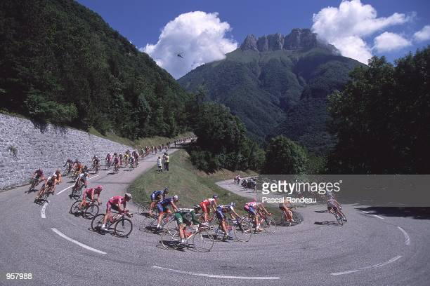 Peloton moves through the Alps during stage 10 of the Tour de France from AixlesBains to Alpe D''Huez in France Mandatory Credit Pascal Rondeau...