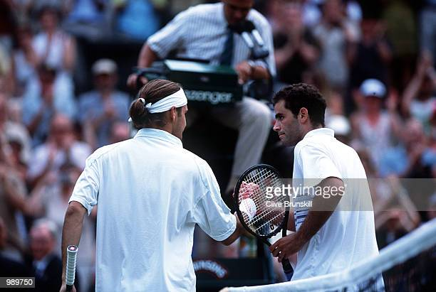 Pete Sampras of the USA congratulates Roger Federer of Switzerland following his victory during the men's fourth round of The All England Lawn Tennis...