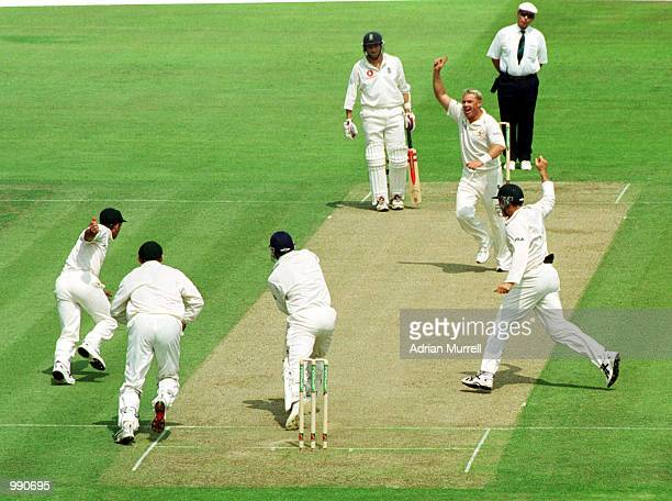 Shane Warne of Australia celebrates taking the wicket of Mark Butcher caught by Ricky Ponting for 38 runs during the opening day of the npower first...
