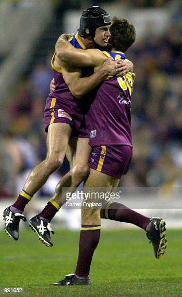 Shaun Hart and Daniel Bradshaw of Brisbane celebrate a lions goal against St Kilda during the round 14 AFL match between the Brisbane Lions and St...