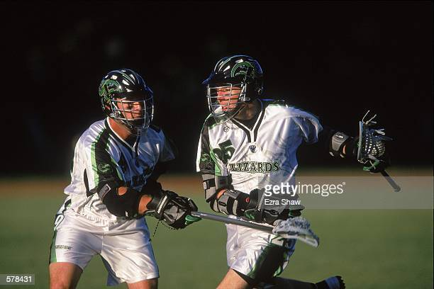 Steven Sambrotto of the Long Island Lizards runs next to a teammate during the Major League Lacrosse game against the Boston Cannons at Cawley Field...