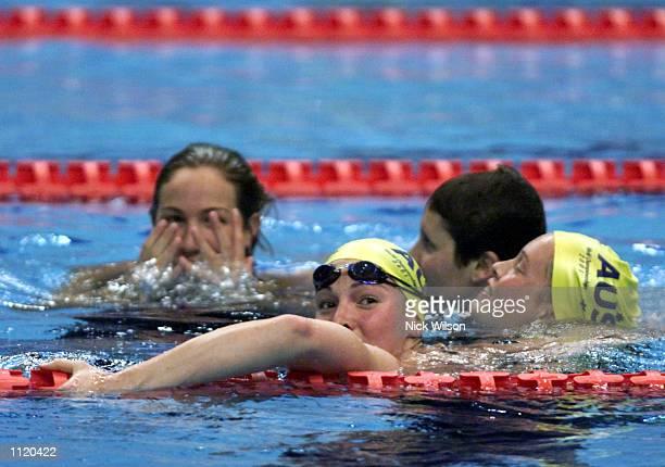 The Australian Womens 4x200m relay team of Elka Graham, Linda MacKenzie, Petria Thomas and Giaan Rooney jump into the pool after Australia finished...