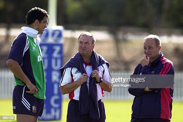 The British Lions management Martin Johnson Andy Robinson and Graham Henry talk tactics during training held at Bruce Stadium in Canberra Australia...