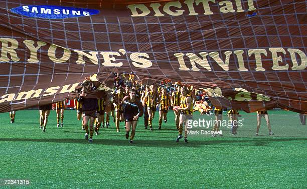The Hawthorn team run through the Hawthorn banner before the round 17 AFL match played between the Hawthorn Hawks and the Carlton Blues played at the...