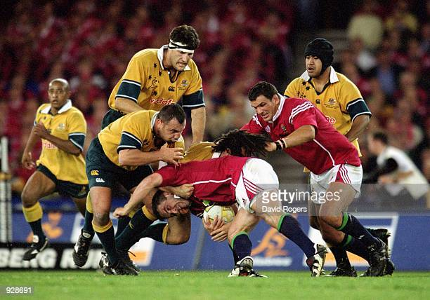 Tom Smith for the Lions drives against Michael Foley and George Smith for the Wallabies during the second Test Match between the Australian Wallabies...